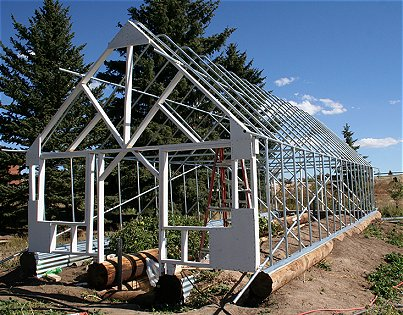 A do it yourself greenhouse built from local materials for Materials to make a greenhouse