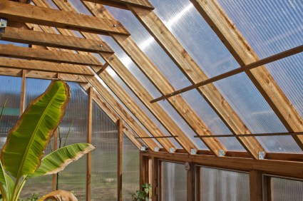 The differences between a pvc greenhouse and a wood greenhouse garden greenhouse for Wooden greenhouse plans designs